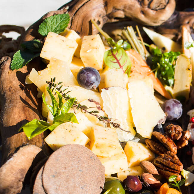 cheese-platter-crackers-nuts-grapes